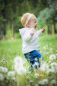 Outdoor portrait of a cute little baby — Stock Photo