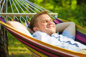 Young man sleeping in a hammock — Foto de Stock