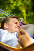 Young man sleeping in a hammock — Stok fotoğraf