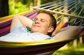 Young man sleeping in a hammock — Stock Photo