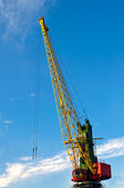 The large industrial crane for cargo containers in port — Stock Photo