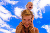 Baby with mother on the beach — Stock Photo