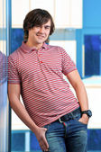 Portait of a young man standing with his hands in pocket — Stock Photo