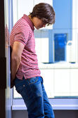 Depressed young man standing — Stock Photo