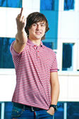 A young man is showing fuck sign with the middle finger — Foto Stock