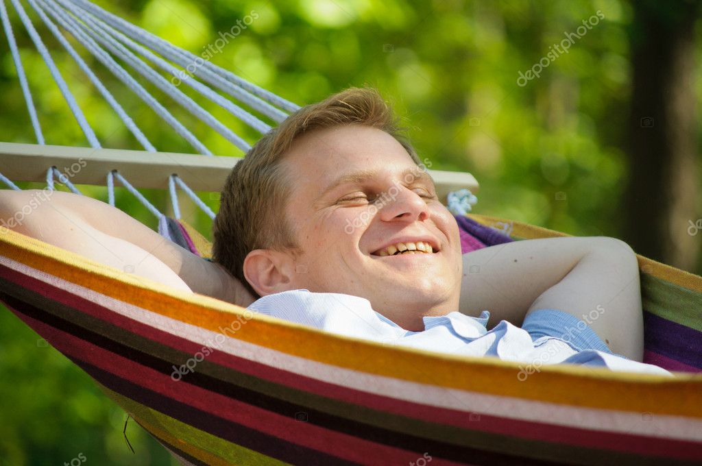 Young man sleeping in a hammock — Stock Photo #6883271
