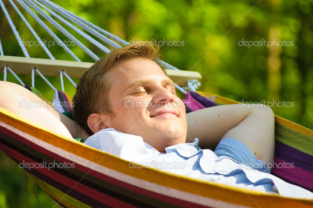 Young man sleeping in a hammock — Stock Photo #6883275