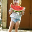 Infant baby with a melon — 图库照片