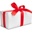 White box with a red ribbon and bow — Stock Photo