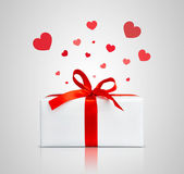 Present box with red ribbon. — Stock Photo