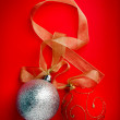 Christmas balls on red background — Stock Photo