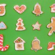 Homemade Gingerbread cookies on green background — Stock Photo