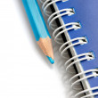 Blue pencil and spiral of notebook — 图库照片