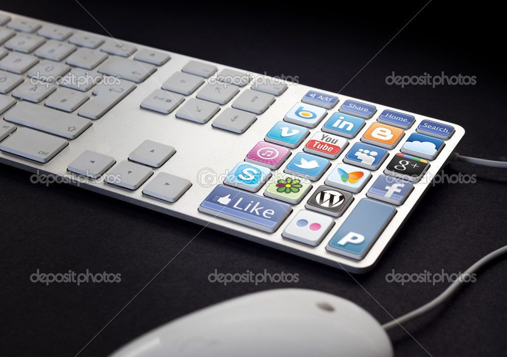 Computer Keyboard with social media and network buttons on black background  Stock Photo #7522948