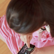 Little girl drawing on  modern touch screen phone — Stock Photo