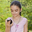Girl listening to music on a smartphone — Stock Photo