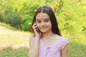 Teenage girl talking on cell phone — Stock Photo