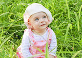 Happy baby girl with blue eyes — Stock Photo