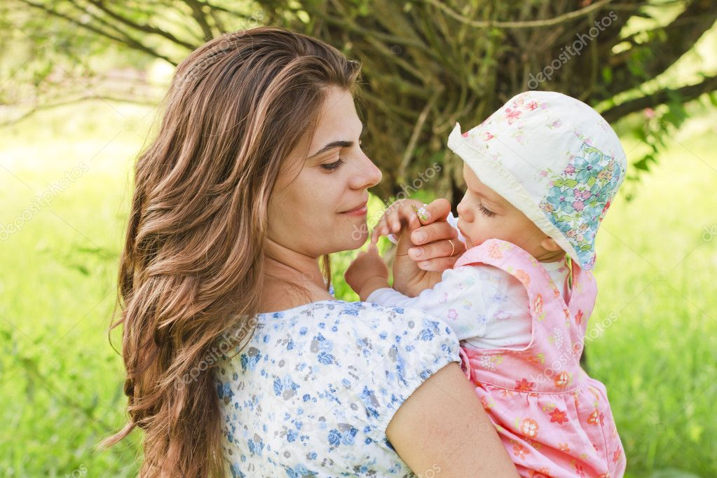 baby girl with her mother giving a flower stock photo stanca mother of girl with down syndrome successful at getting photos mocking her daughter removed from facebook 1024x682