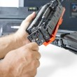 Hands repairing toner cartridge - Stock Photo