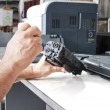 Hands repairing toner cartridge — Stock Photo