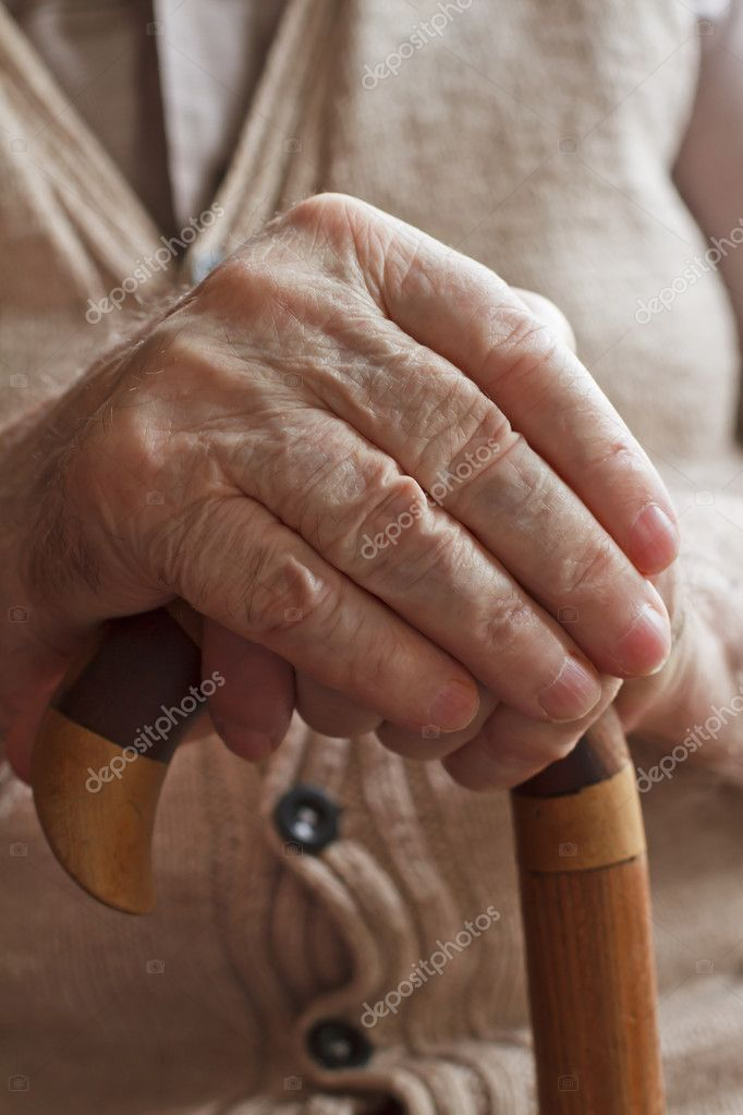 Hand of a senior man holding a cane — Stock Photo #7087189