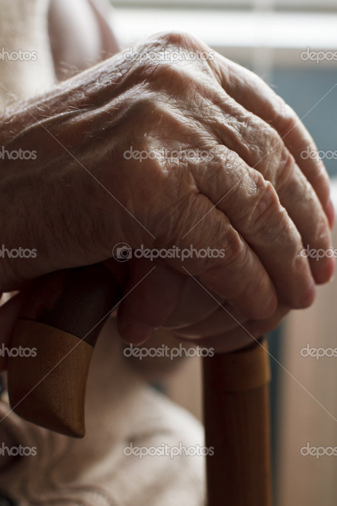 Hand of a senior man holding a cane — Stock Photo #7087194