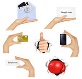 Set of hands holding different business objects and red boxing glove illust — Stock Vector