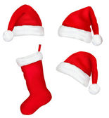 Three red santa hats and christmas stocking. Vector illustration. — Stock Vector