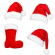 Set of red santa hats and boot. Vector. — Stock Vector
