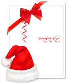 Red bow with ribbons and Santa hat. Vector. — Stock Vector
