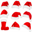 Big set of red santa hats and boot. Vector. — Stock Vector #7792146