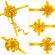 Set of gold gift bows with ribbons. Vector. — Stock Vector