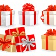 Set of colorful vector gift boxes with bows and ribbons. — Imagens vectoriais em stock