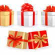 Royalty-Free Stock Vectorafbeeldingen: Set of colorful vector gift boxes with bows and ribbons.
