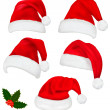 Collection of red santa hats with and Christmas holly. Vector. — 图库矢量图片