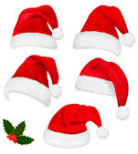 Collection of red santa hats with and Christmas holly. Vector. — Stockvector