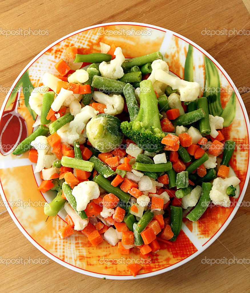 Plate with frozen vegetables  Stock Photo #6951789