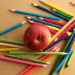 Stock Photo: Color pencils with apple