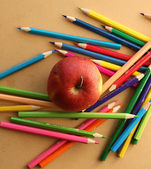 Color pencils with apple — Stock Photo