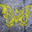 Butterfly on the ground. The graffity painting — Stok fotoğraf