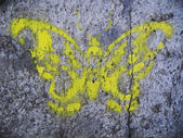 Motyl na ziemi. malarstwo graffity — Zdjęcie stockowe