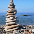 Balanced stones on the seashore summertime - Stock Photo