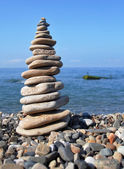 Balanced stones on the seashore summertime — Stock Photo