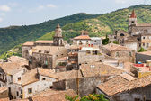View on ancient tile roofs and tower of Sant Antonio church in Castiglione — Stock Photo