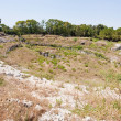 Antique Roman amphitheater in Syracuse, - Stock Photo