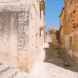Narrow street in baroque style town - Stock Photo