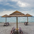 Empty Ionian sea beach in overcast day, Sicily - Stock Photo