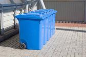 Blue plastic recycling bins — Stock Photo