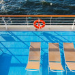 Stock Photo: Sunbath chairs on cruise liner